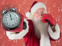 Composite image of santa claus punches with his right Royalty Free Stock Photography
