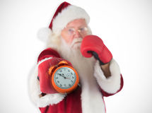 Composite image of santa claus punches with his right Royalty Free Stock Photos