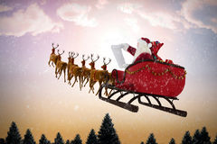 Composite image of santa claus riding on sled during christmas Royalty Free Stock Image