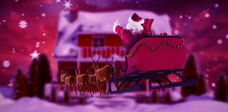 Composite image of santa claus riding on sleigh during christmas. Santa Claus riding on sleigh during Christmas against composite image of fir trees in snowy Stock Images