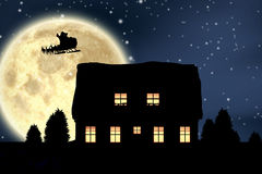 Composite image of santa claus riding on sleigh during christmas. Santa Claus riding on sleigh during Christmas against composite image of full moon Royalty Free Stock Photography