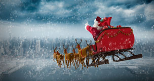 Composite image of santa claus riding on sleigh with gift box Royalty Free Stock Photo
