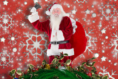 Composite image of santa claus ringing bell Stock Images