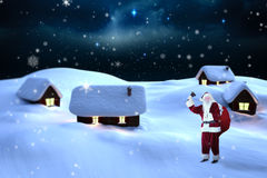 Composite image of santa claus ringing bell Stock Photo