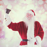 Composite image of santa claus rings his bell Royalty Free Stock Photos