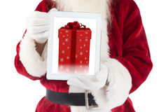 Composite image of santa claus showing tablet pc Stock Images