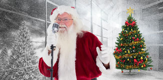 Composite image of santa claus is singing christmas songs Royalty Free Stock Photo