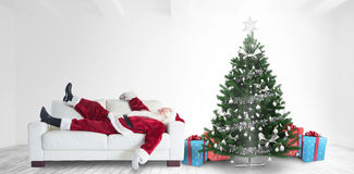 Composite image of santa claus taking a nap Royalty Free Stock Image