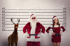 Composite image of santa claus wears black sunglasses Royalty Free Stock Image