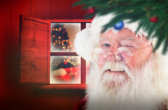 Composite image of santa claus winking Royalty Free Stock Image