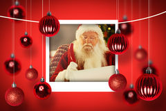 Composite image of santa claus writing his list with a quill Stock Photos