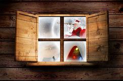 Composite image of santa delivery presents to village Stock Photo