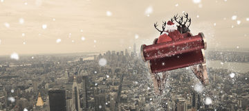 Composite image of santa flying his sleigh. Santa flying his sleigh against new york Royalty Free Stock Photo