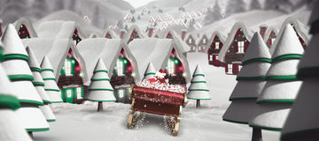 Composite image of santa flying his sleigh. Santa flying his sleigh against quaint town with bright moon Stock Images
