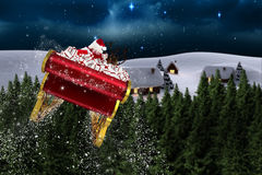 Composite image of santa flying his sleigh Stock Photos
