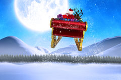Composite image of santa flying his sleigh Stock Photo