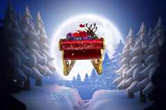 Composite image of santa flying his sleigh Royalty Free Stock Images