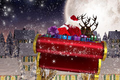 Composite image of santa flying his sleigh Stock Image
