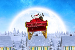 Composite image of santa flying his sleigh Royalty Free Stock Image