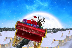 Composite image of santa flying his sleigh Royalty Free Stock Photography