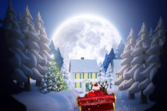 Composite image of santa flying his sleigh Stock Images