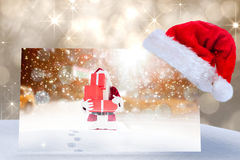 Composite image of santa hat on poster Stock Photography