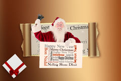 Composite image of santa holds a sign and rings his bell Royalty Free Stock Images