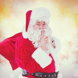 Composite image of santa keeping a secret and holding his sack Stock Photos