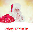Composite image of santa keeping a secret and holding his sack Stock Images