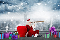Composite image of santa looking through a telescope Royalty Free Stock Images