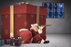 Composite image of santa looking through a telescope Stock Photos