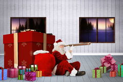 Composite image of santa looking through a telescope Royalty Free Stock Photos