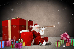 Composite image of santa looking through a telescope Royalty Free Stock Photography