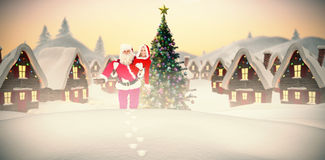 Composite image of santa and mrs claus smiling at camera Royalty Free Stock Photography