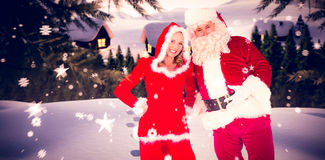 Composite image of santa and mrs claus smiling at camera Stock Photography