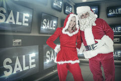 Composite image of santa and mrs claus smiling at camera Royalty Free Stock Photo