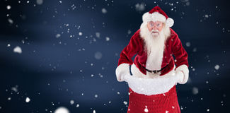 Composite image of santa open his red bag Stock Image