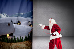 Composite image of santa pulls something with a rope Stock Photos