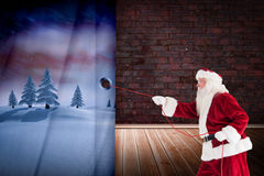 Composite image of santa pulls something with a rope Stock Images