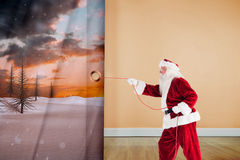 Composite image of santa pulls something with a rope Stock Photo