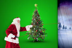 Composite image of santa pulls something with a rope Stock Photography