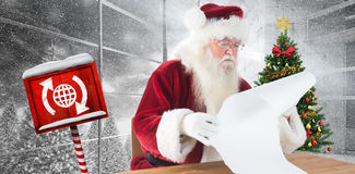 Composite image of santa reads a long list Royalty Free Stock Photography