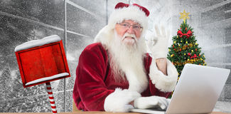 Composite image of santa is satisfied about what he found Royalty Free Stock Photography