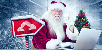 Composite image of santa is satisfied about what he found Stock Image