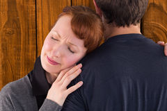 Composite image of scared woman holding onto man royalty free stock images
