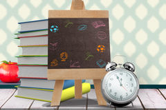 Composite image of school activity doodles. School activity doodles against  composite image of black board Composite image of black board against wooden planks Royalty Free Stock Photo