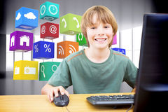 Composite image of school kid on computer Stock Photos