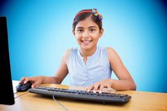 Composite image of school kid on computer Royalty Free Stock Photography