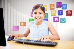 Composite image of school kid on computer Stock Photography