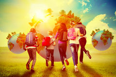 Composite image of school kids running in school corridor Royalty Free Stock Images